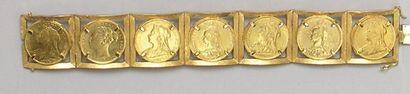 Large BRACELET articulé en or jaune serti...