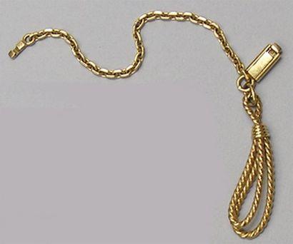 PORTE-CLE «cordelette nouée» en or jaune....