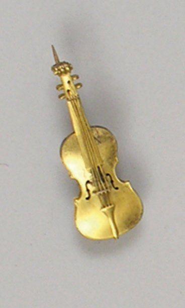 BROCHE en forme de violon en or jaune ( 14k),...