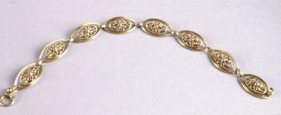 BRACELET en or jaune articulé à motif de fleurs. L.: 19 cm - Poids: 19,4 g