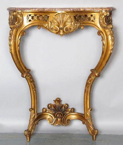 CONSOLE de style Louis XV en bois doré mouluré,...