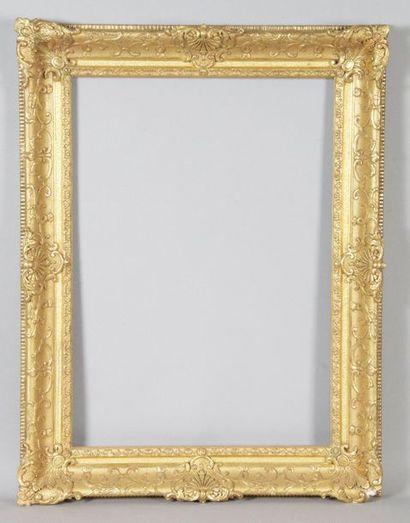 CADRE en bois doré de style Louis XIV. Régence....