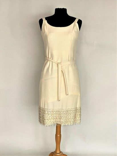 Sleeveless dress in ivory wool and fringes...