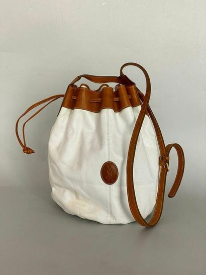 YVES SAINT LAURENT. White and tan leather...