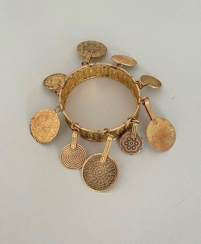 YVES SAINT LAURENT Bracelet rigide en métal...