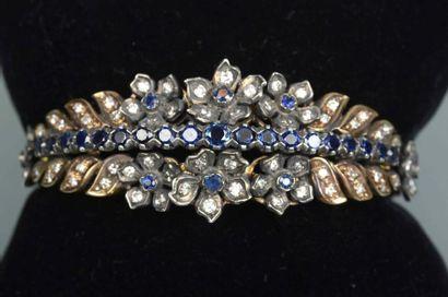 Bracelet fleur semi rigide en or et argent...