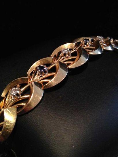 Bracelet en or et platine à maillons rayonnants,...