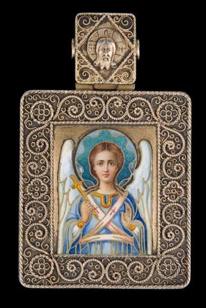 Icone pendentif en argent doré à décor émaillé...