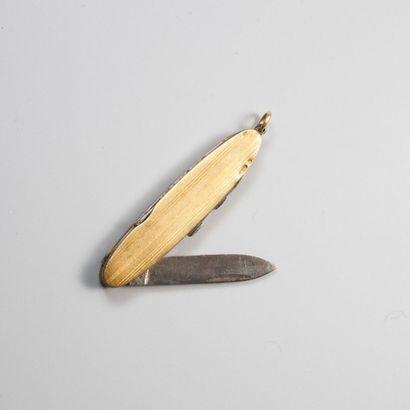 Couteau suisse en or 750millièmes et acier...