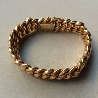 Bracelet gourmette US en or 750 millièmes....