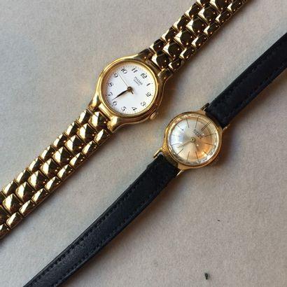 2 montres de dame en métal doré PULSAR er...