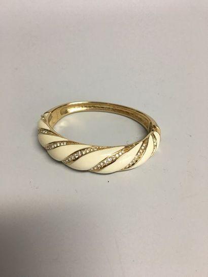 GROSSE  Bracelet jonc ouvrant en métal doré...