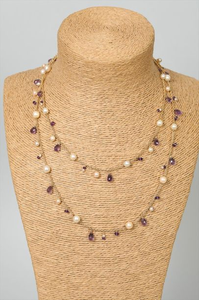 Sautoir en or 750 millièmes alterné de perles...