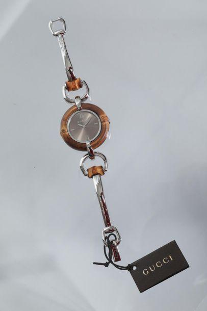 GUCCI n° 15160529  Montre modèle bambo acier...