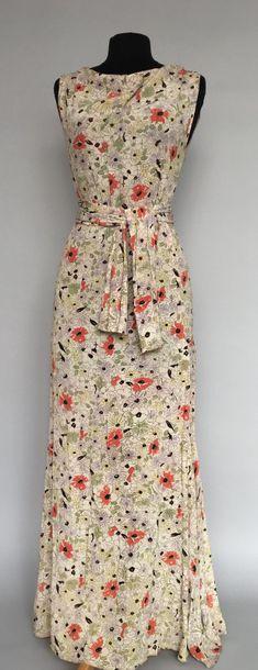 Robe longue en crêpe ivoire et imprimé floral...