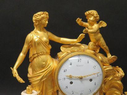 Pendule en marbre et bronze ciselé doré à décor d'une femme à l'antique et d'un...