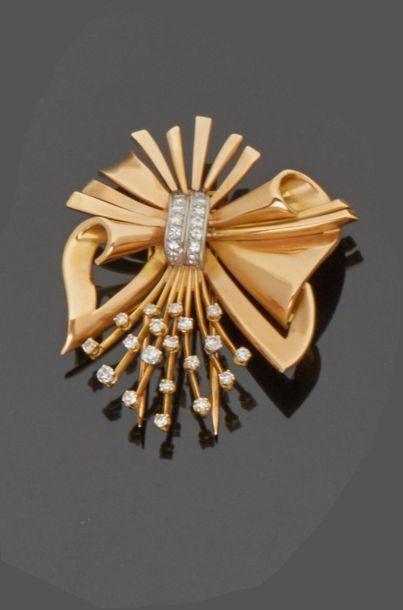 Broche clip noeud en or jaune 18 k (750 millièmes)...