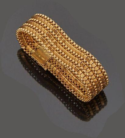 Bracelet articulé en or jaune 18 k (750 millièmes)...