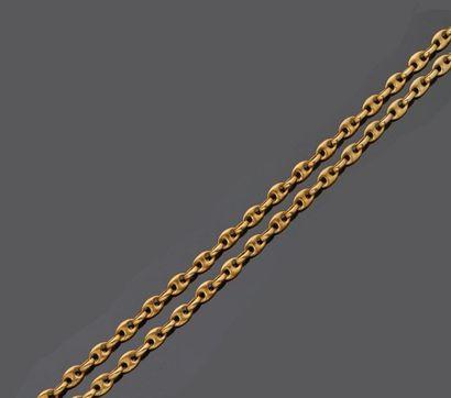 Collier sautoir en or jaune 18 k (750 millièmes)...
