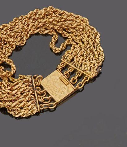 Bracelet orné de sept chaînettes en or jaune...