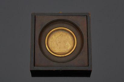 Cadre biface encadrant une médaille en bronze...