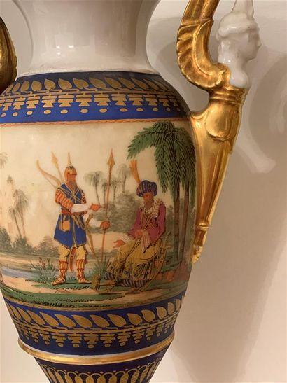 Paire de vases de forme balustre en porcelaine polychrome et dorée à décor de scènes...