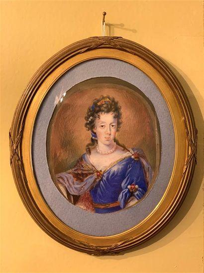 Miniature à vue ovale représentant une femme...