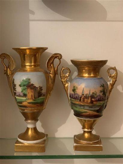 Deux vases en porcelaine polychrome et dorée...