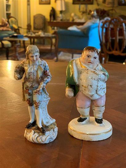 Deux personnages en porcelaine polychrome...