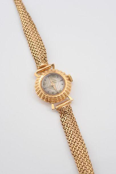 Montre de dame en or 750‰, bracelet en maille d'or.  Poids brut: 20,8 g