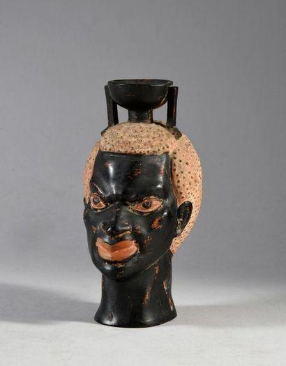 Vase à tête de Nubien, terre cuite à décor...