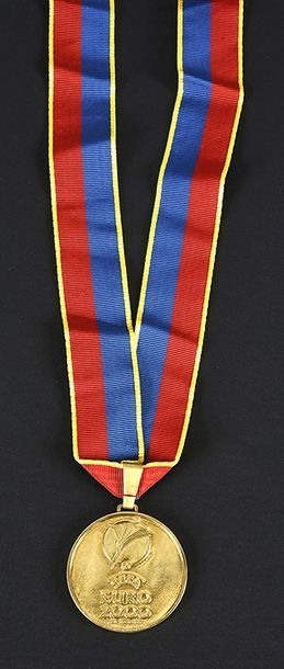 Winner's gold medal awarded to the players and staff of the French Team for their...