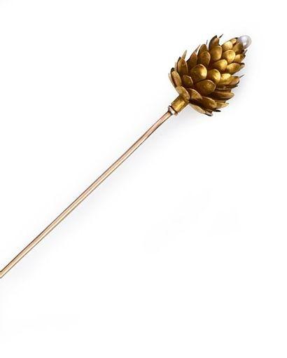 Epingle à chapeau en or 750°° à décor de...