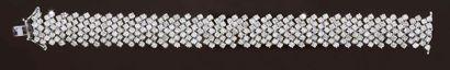 Bracelet ruban en or 750°°, serti de diamants...