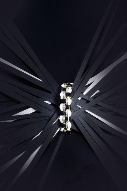 Elégant bracelet articulé en or 750°°, à...
