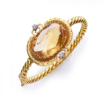 Bracelet jonc en or 750°° torsadé, orné d'un...