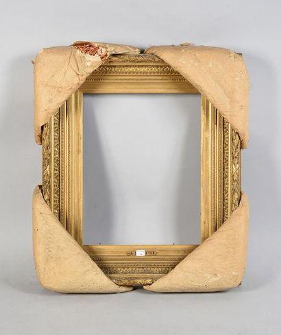 Beau cadre en bois et stuc doré dit Barbizon....