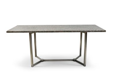 Dining room table. The pink granite top rests...
