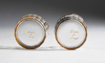 DAUM Nancy Two cut crystal saltcellars, enamelled decoration of landscapes in grisaille....