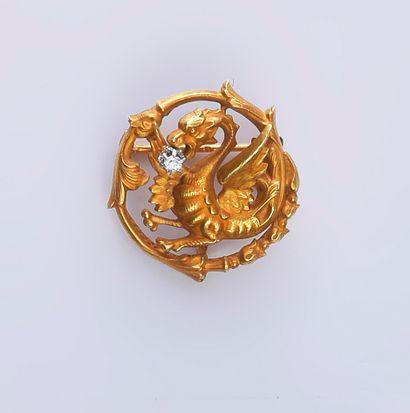 Broche ronde en or 750e à motif de dragon...