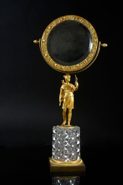 Psyché de table en bronze doré, le miroir...