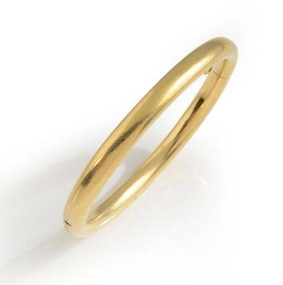 Bracelet jonc ouvrant en or jaune 18K. Longueur:...