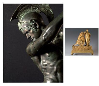 Pendule en bronze ciselé et doré ornée d'une...
