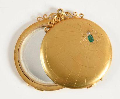 Miroir de poche en or jaune 750 millièmes, pivotant, à décor d'une toile d'araignée...