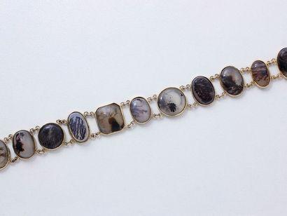 Délicat bracelet articulé en or 750 millièmes,...