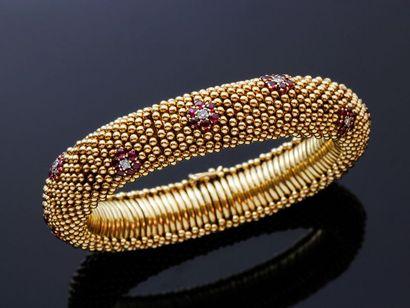 Bracelet souple en or 750 millièmes, décoré...
