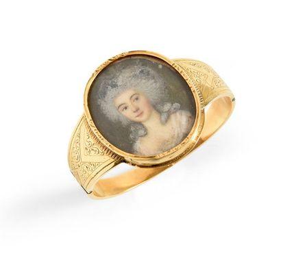 Bracelet en or jaune 750°° gravé de rinceaux...