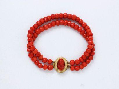 Bracelet articulé composé de 2 rangs de perles...