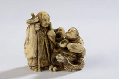 Netsuke en ivoire, Chorio assis sur un dragon...