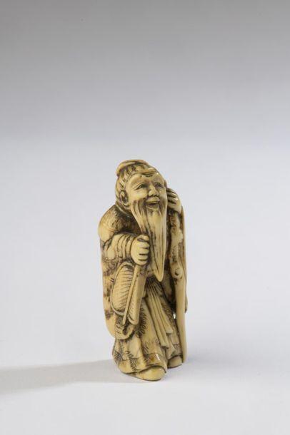 Netsuke en ivoire, sage ou immortel debout...